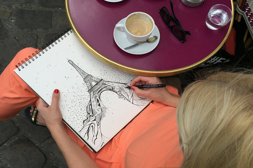 Kelsey sketches at a street cafe in Paris
