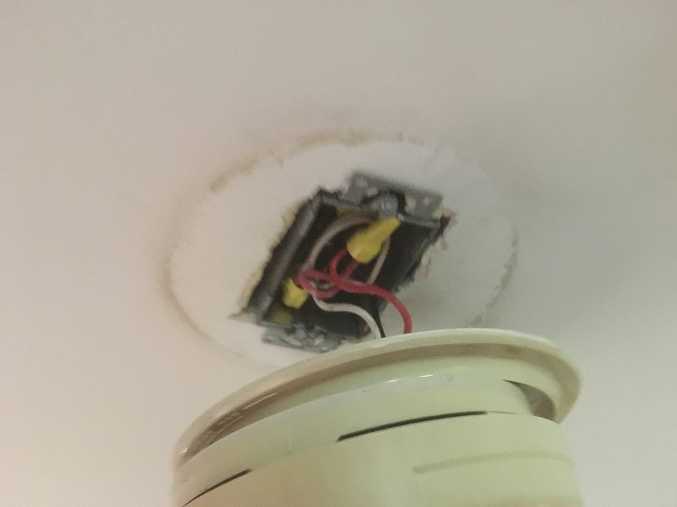 Once the power is off, remove old smoke detector from ceiling.