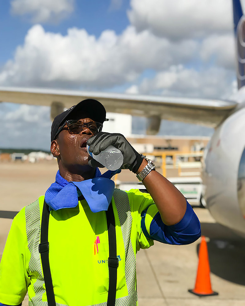 United ramp employee hydrating on the job
