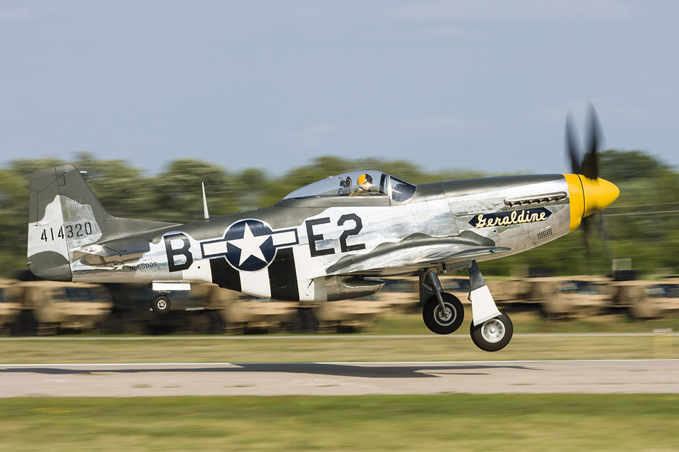 A P-51 Mustang takes off from Oshkosh, Wisconsin, during EAA Airventure.