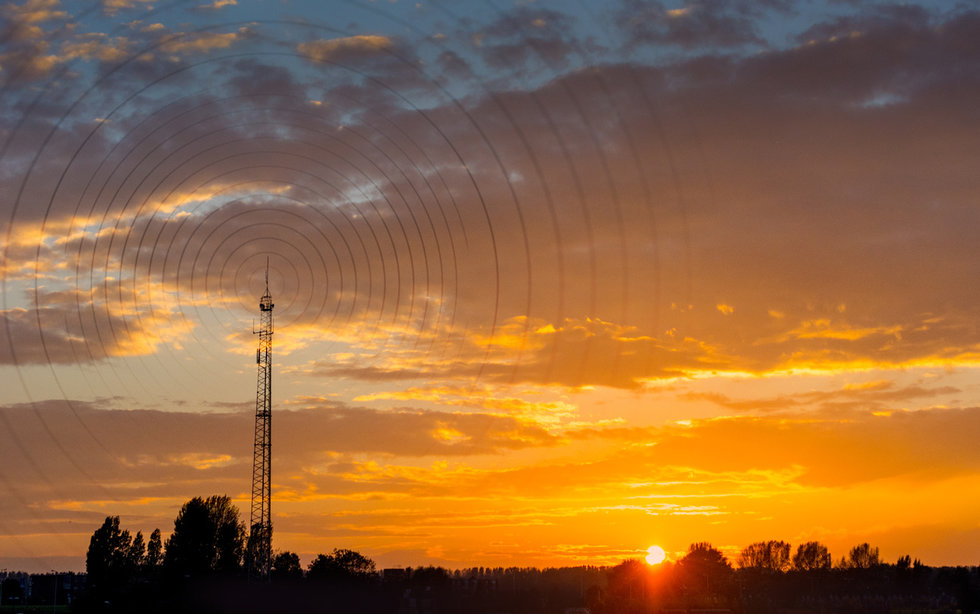 picture of cell tower in the sunset