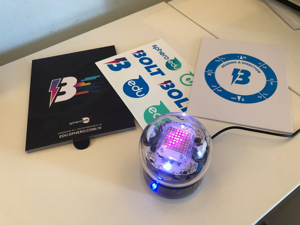 Picture of Sphero bolt on a desk with instructions.