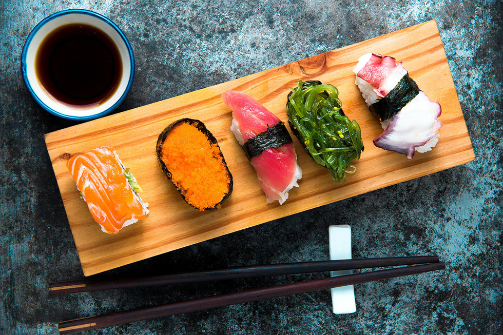 Sushi on a wooden set.