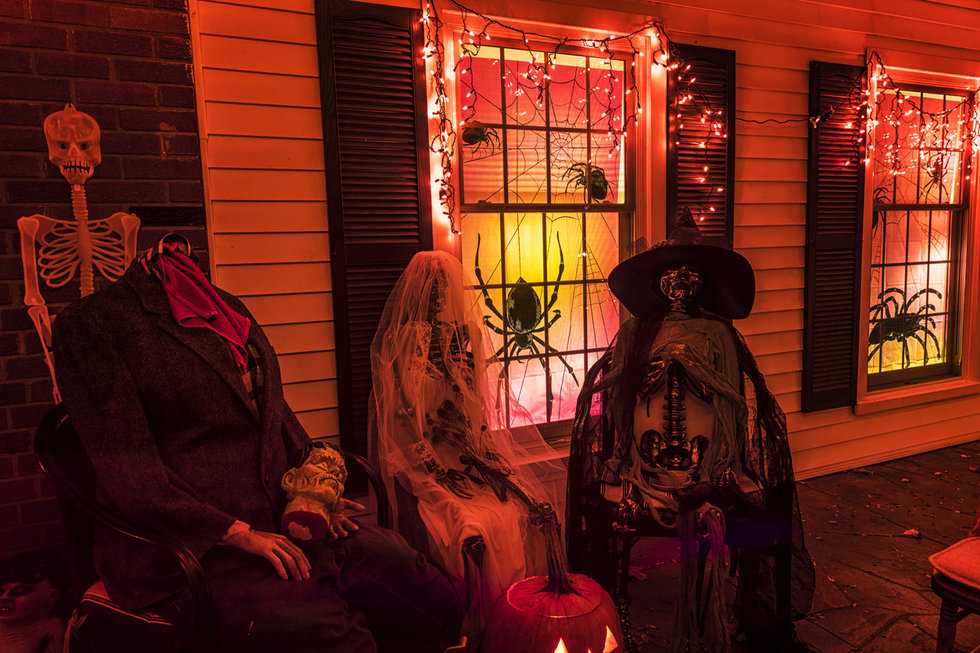 Picture of kids on halloween with motion sensors lighting up front porch.
