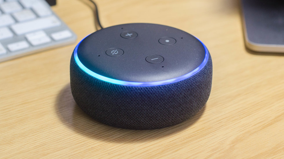 Picture of Echo Dot on a desktop.