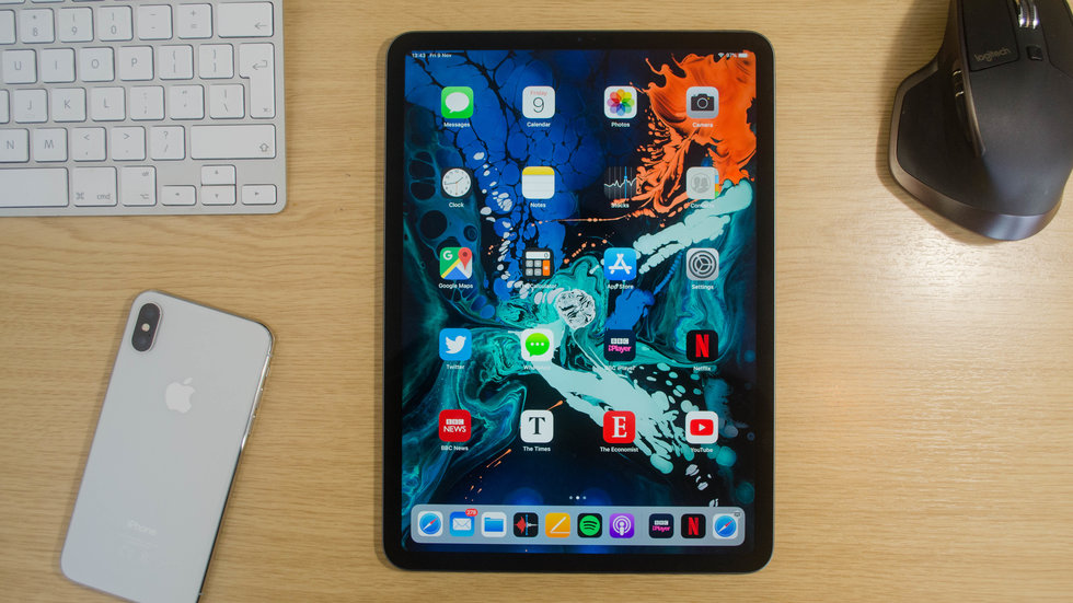 Picture of Apple iPad Pro 11 on a desk next to an iPhone.