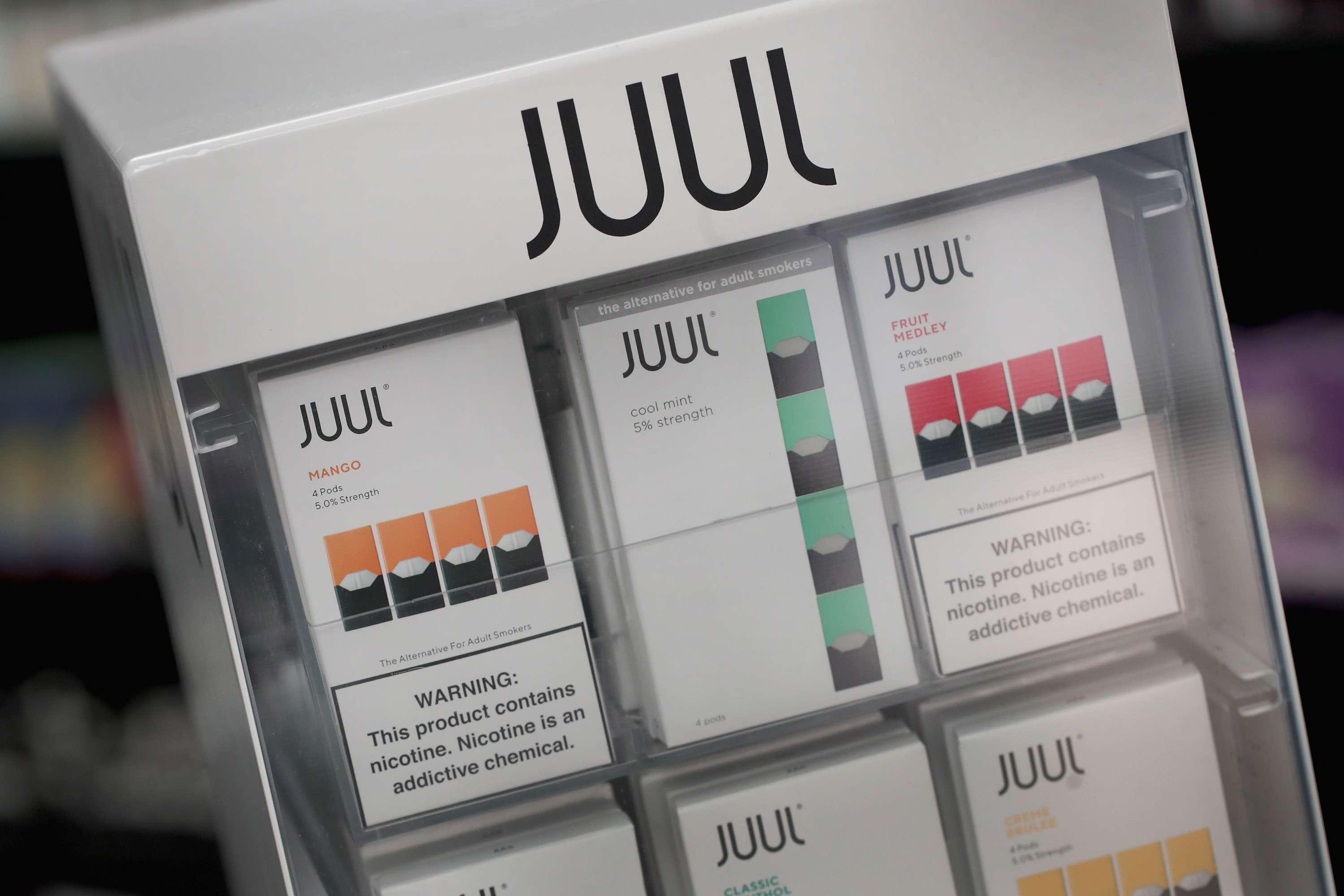 Juul to stop selling most e-cigarettes in stores, leave social media
