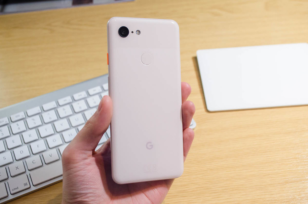 Picture of hand holding a Google Pixel 3 smartphone with backside exposed.