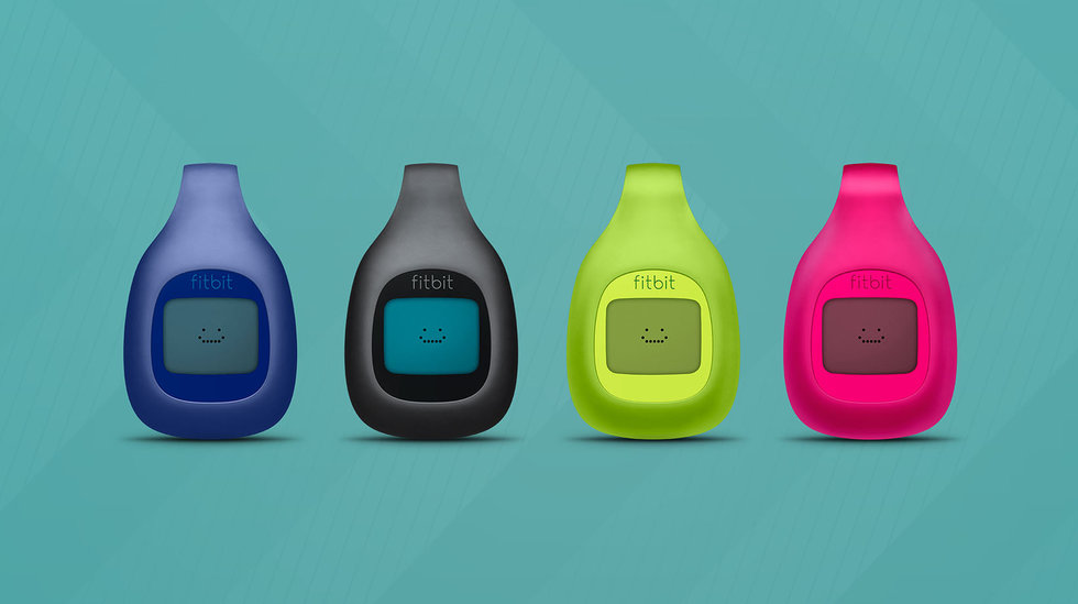 Picture of 4 fitbit zip devices.