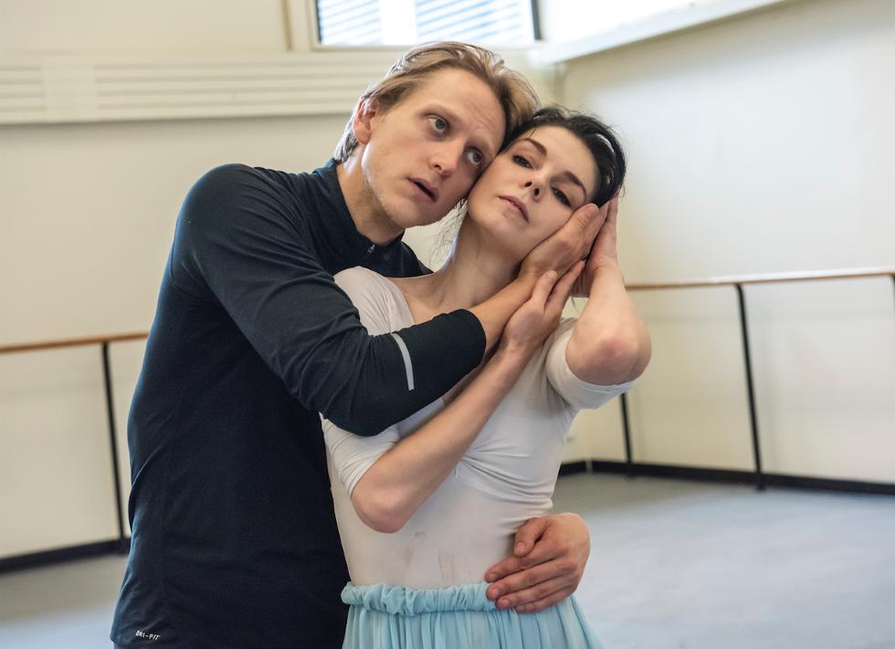 David Hallberg cradles Natalia Osipva's head in his hands in this dramatic closeup