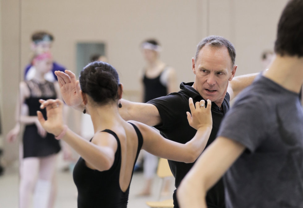 Brandsen demonstrating an arm movement for a dancer in rehearsal.
