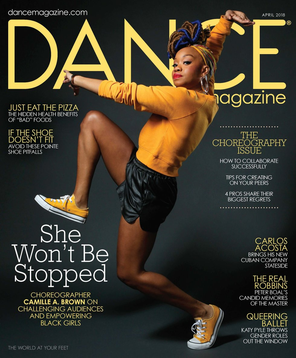 Dance Magazine's April cover featuring a triumphant Camille A. Brown in a bright yellow sweater and sneakers