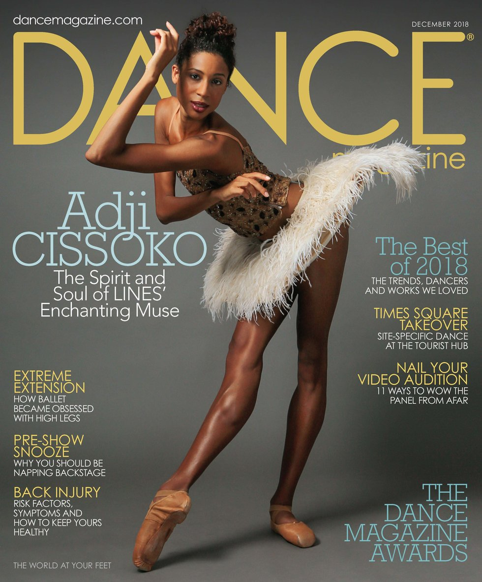Dance Magazine's December cover featuring dancer Adji Cissoko in pointe shoes and a feather tutu