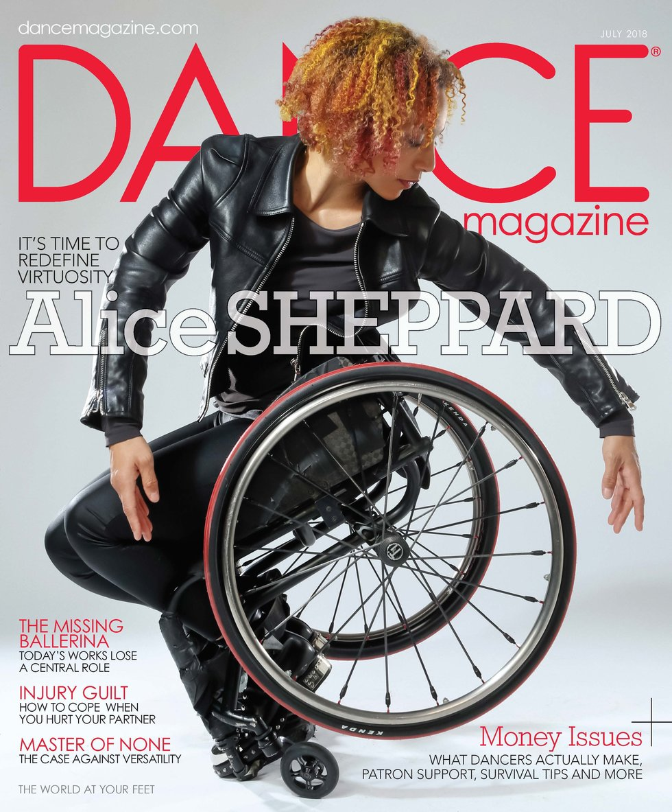 Dance Magazine's July cover featuring Alice Sheppard in a wheelchair, arms surrounding one of the wheels
