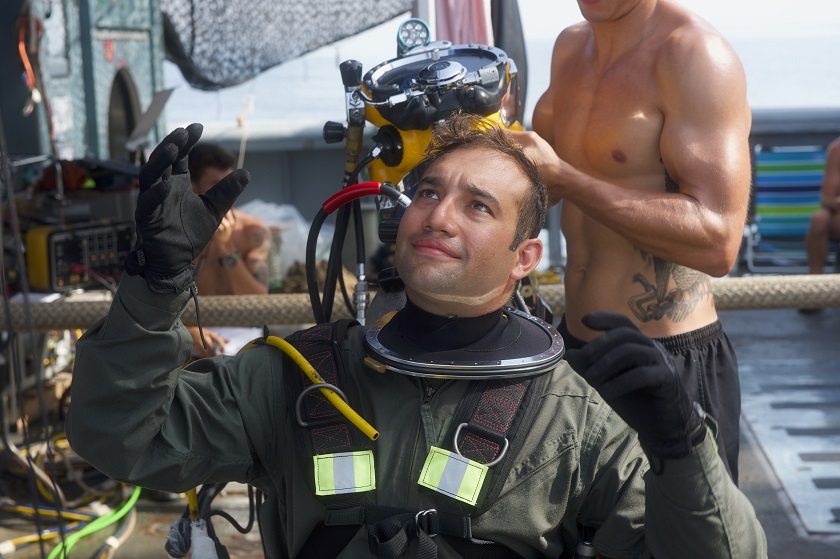 e95ab10a06 Navy divers like Tommy McConnell have those qualities in spades. They also  have a few traditions that set them apart. Such as doling out parting gifts  to ...