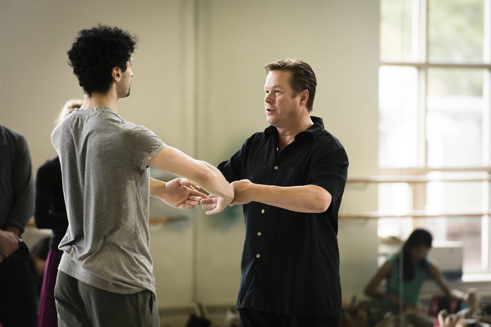 Nissinen corrects the port de bras of a dancer in rehearsal
