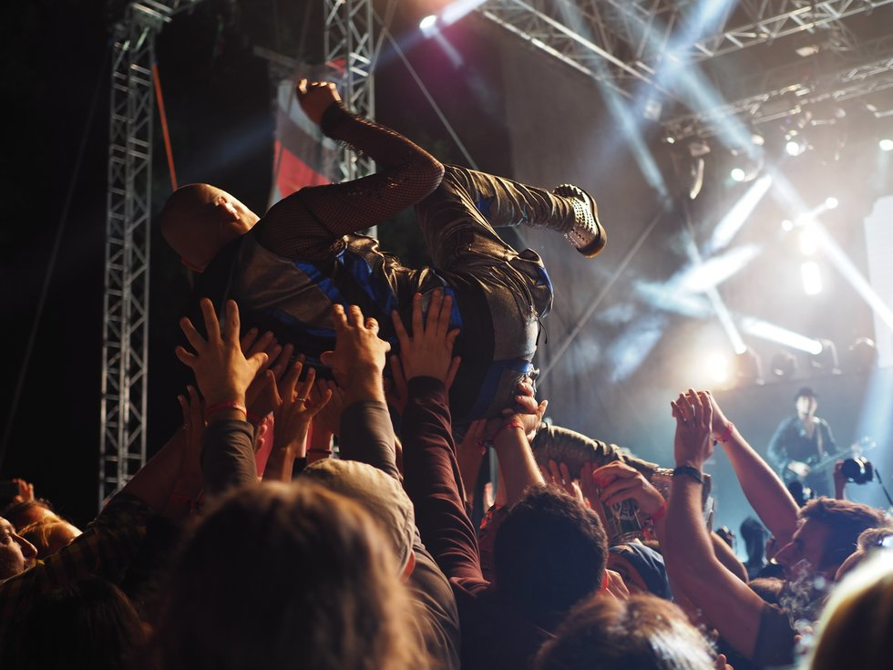 Crowd surfer held up by crowd