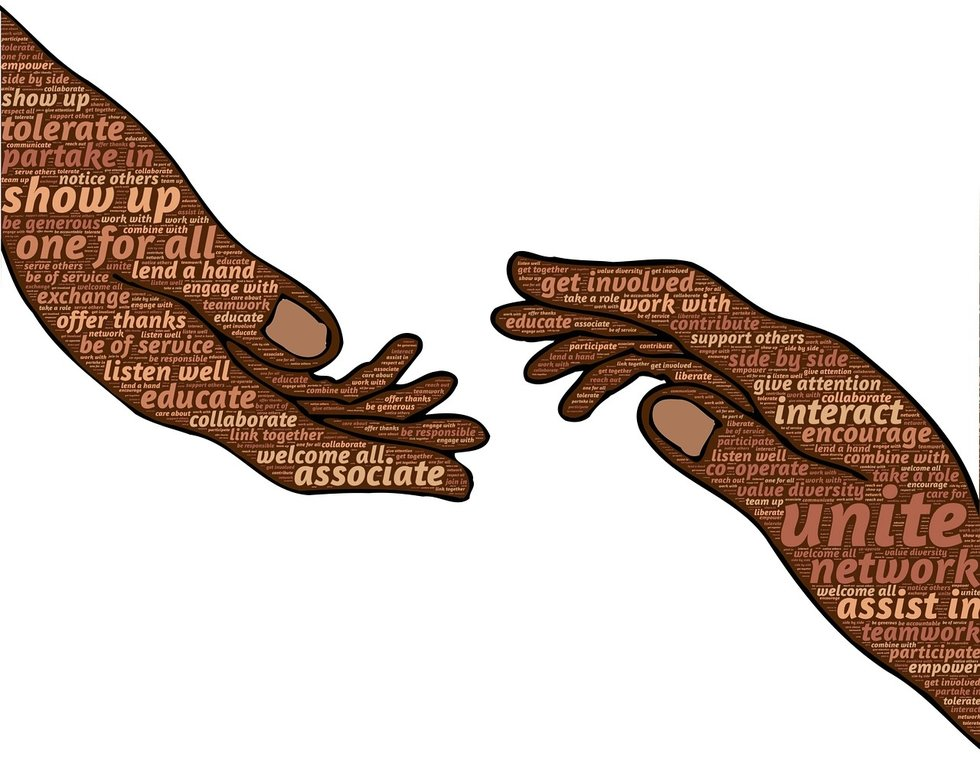 Hands with words of uniting on them