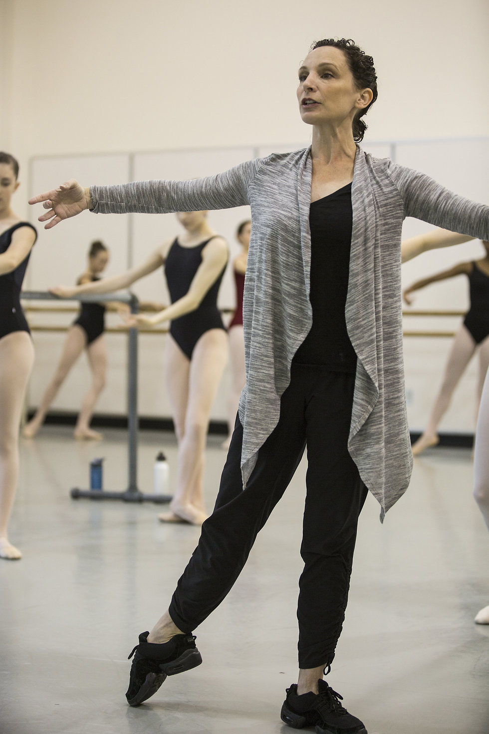 Albee in the front of the classroom, demonstrating tendue side. Her students are at the barre.