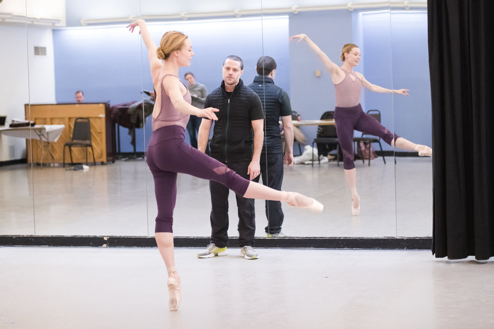 Josh Bergasse watches Sara Mearns on pointe in a developpe front