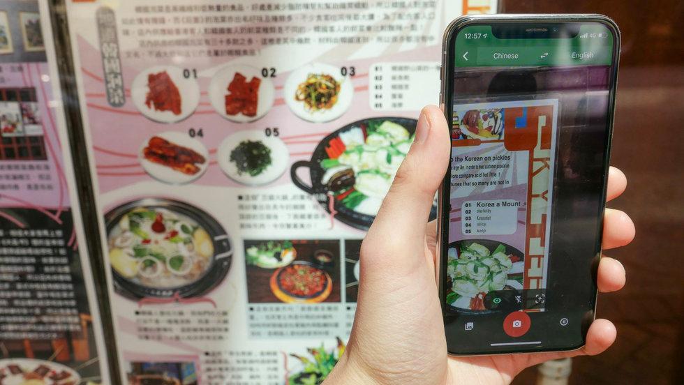 Photo of a smartphone app translating a Chinese restaurant menu in Hong Kong
