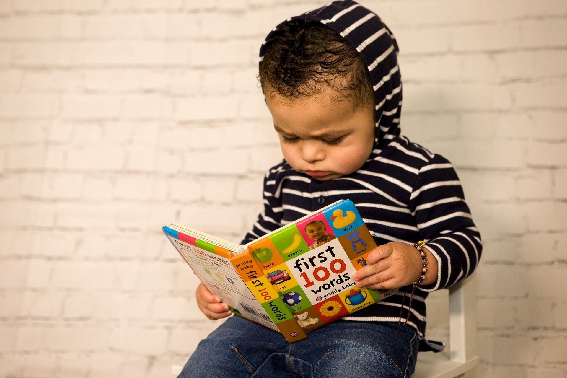 Toddlers engage more with print books than ebooks, developmental researchers say