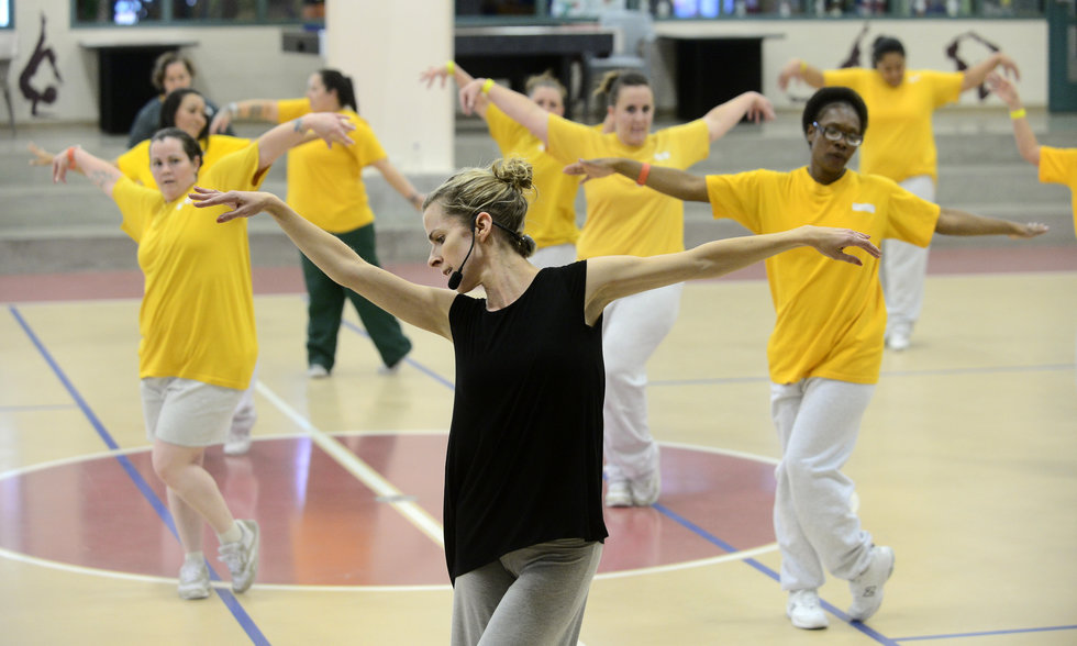 Lucy Wallace leads a Dance To Be Free class in a gym.