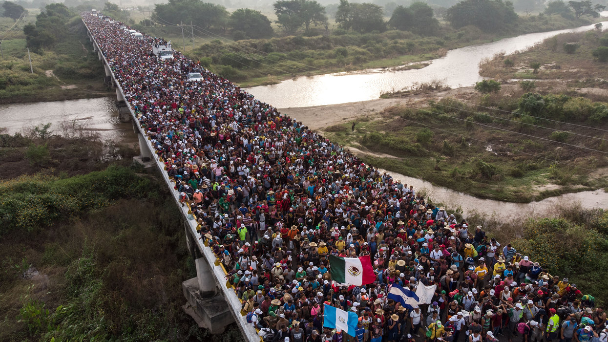 'Hostile' migrants break border gate to enter Mexico, then attack police — and they're headed north