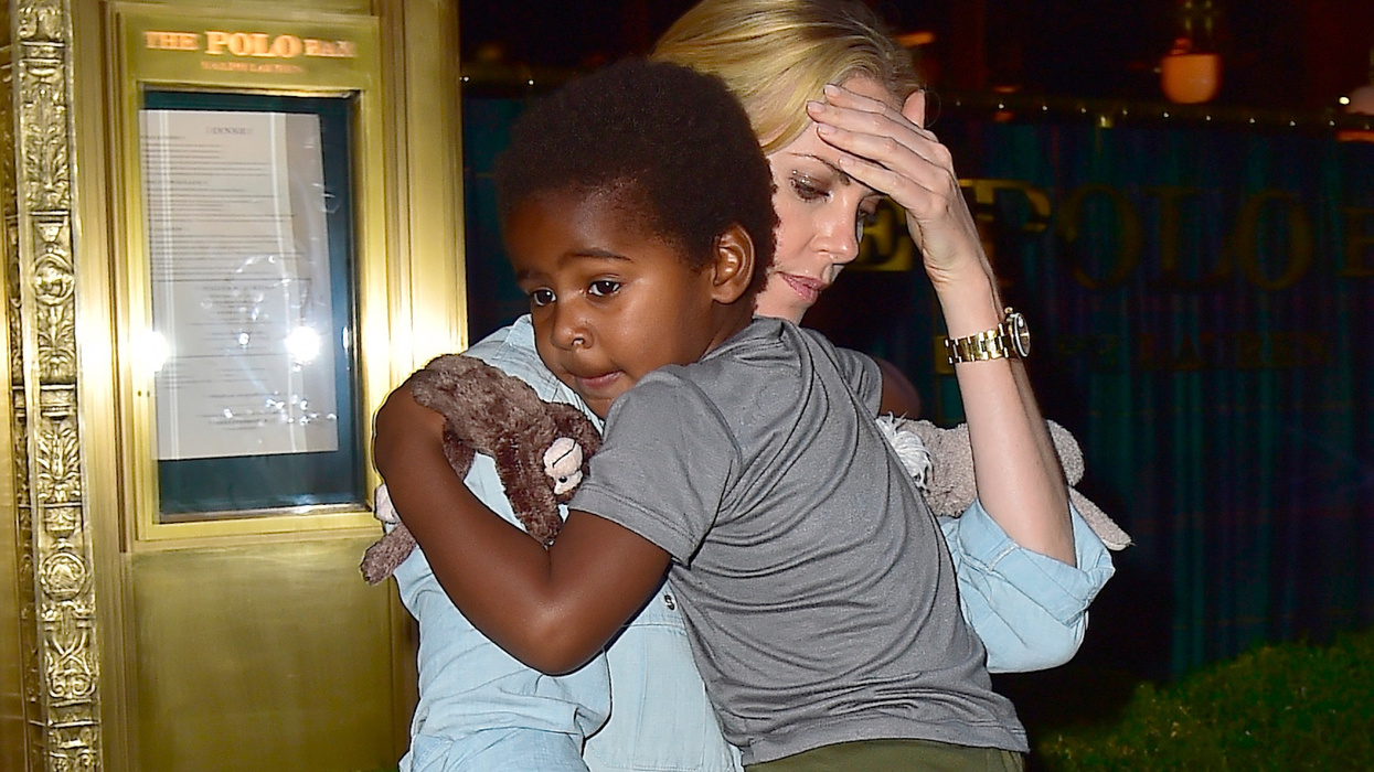 Actress Charlize Theron says the 7-year-old male child she adopted is actually a girl: 'I thought she was a boy, too'