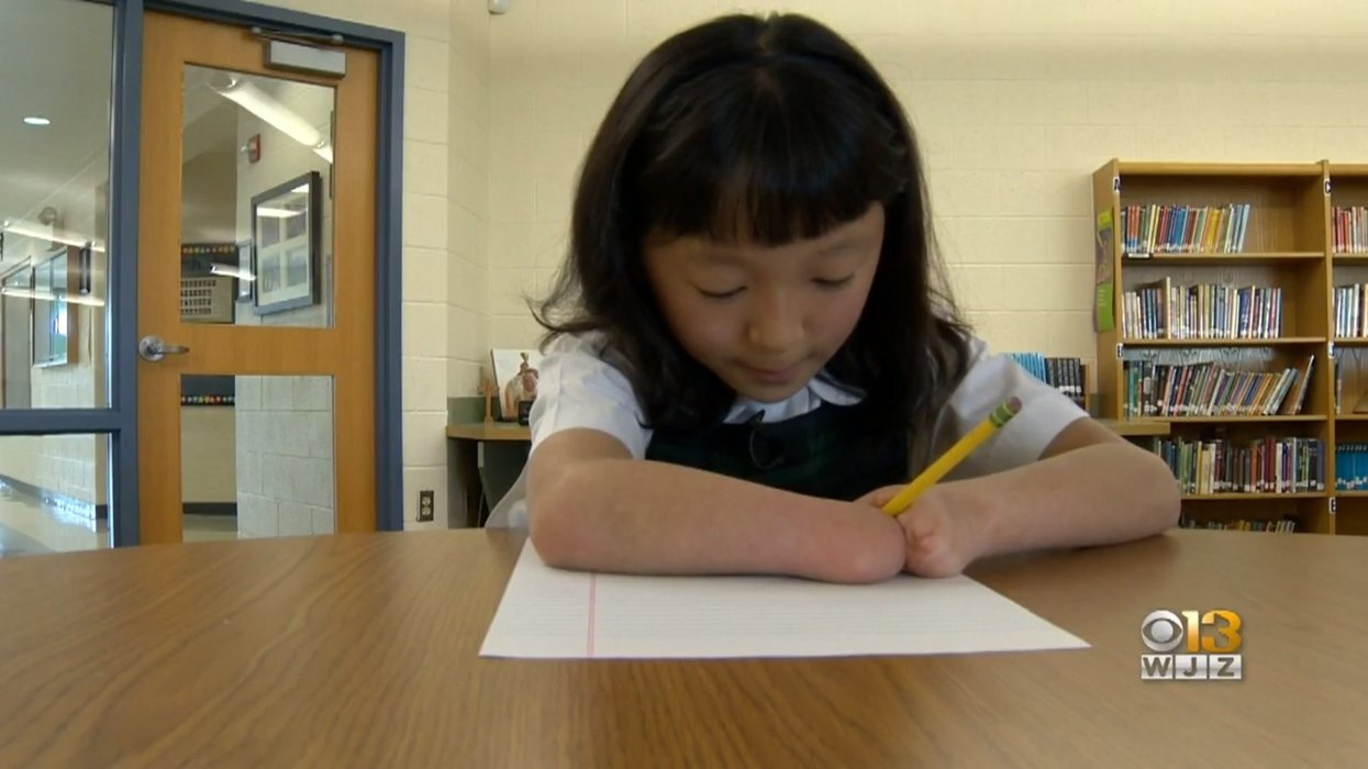 Young girl without hands wins national handwriting competition