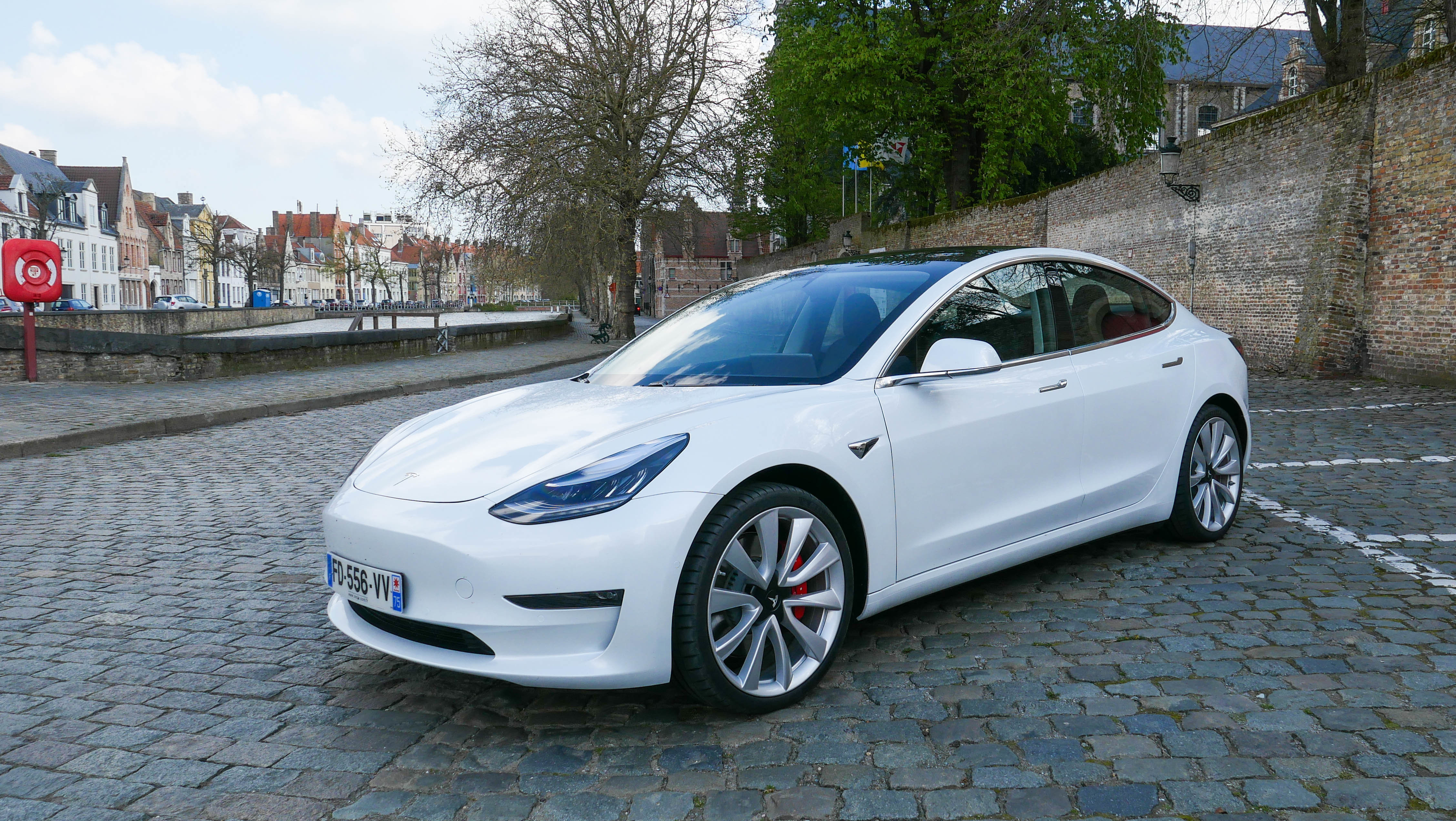 Is the Tesla Model 3 a luxury car? Or is it overpriced