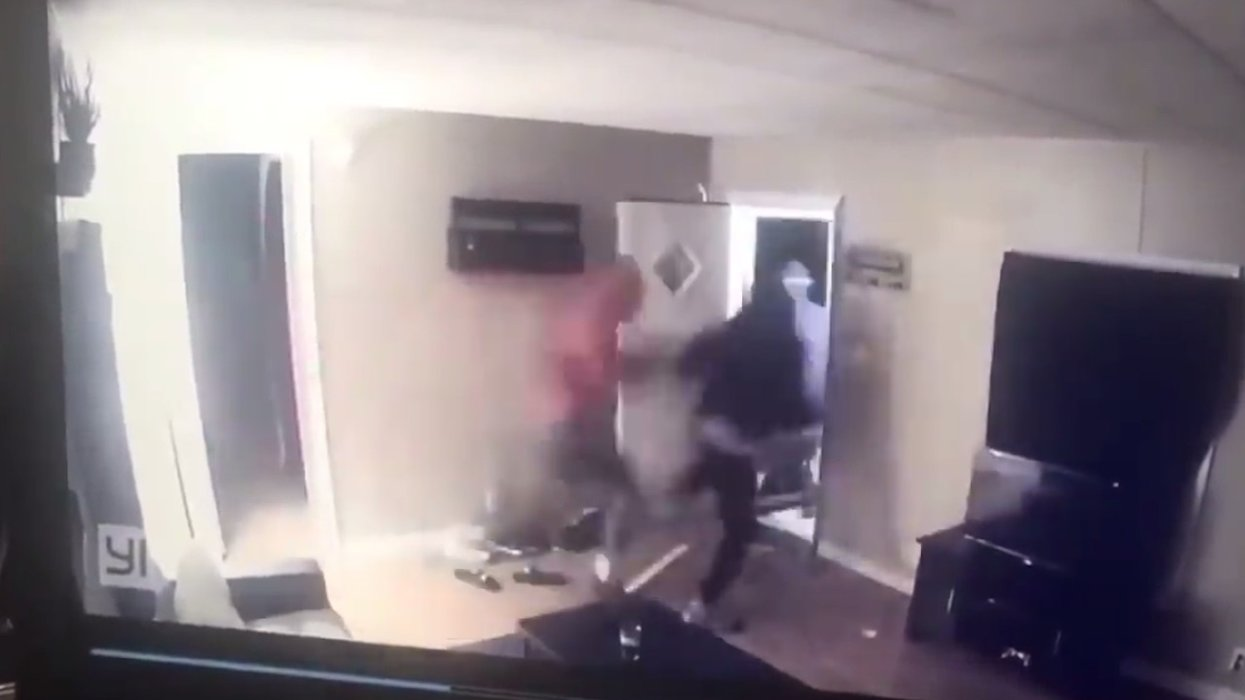 WATCH: Four armed men bust down door in home invasion — then suddenly change their minds when homeowner opens fire