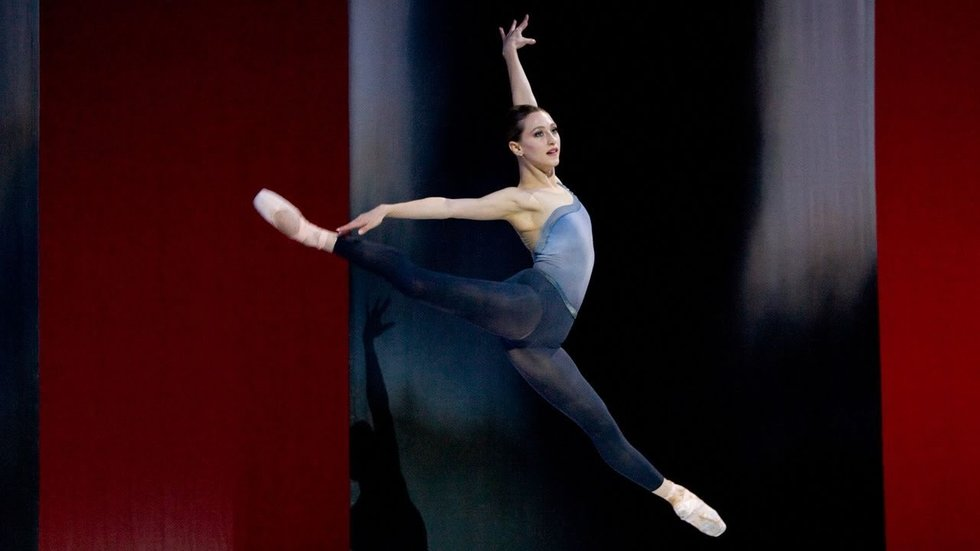 Van Patten in a contemporary ballet piece, jumping with her legs in a split.