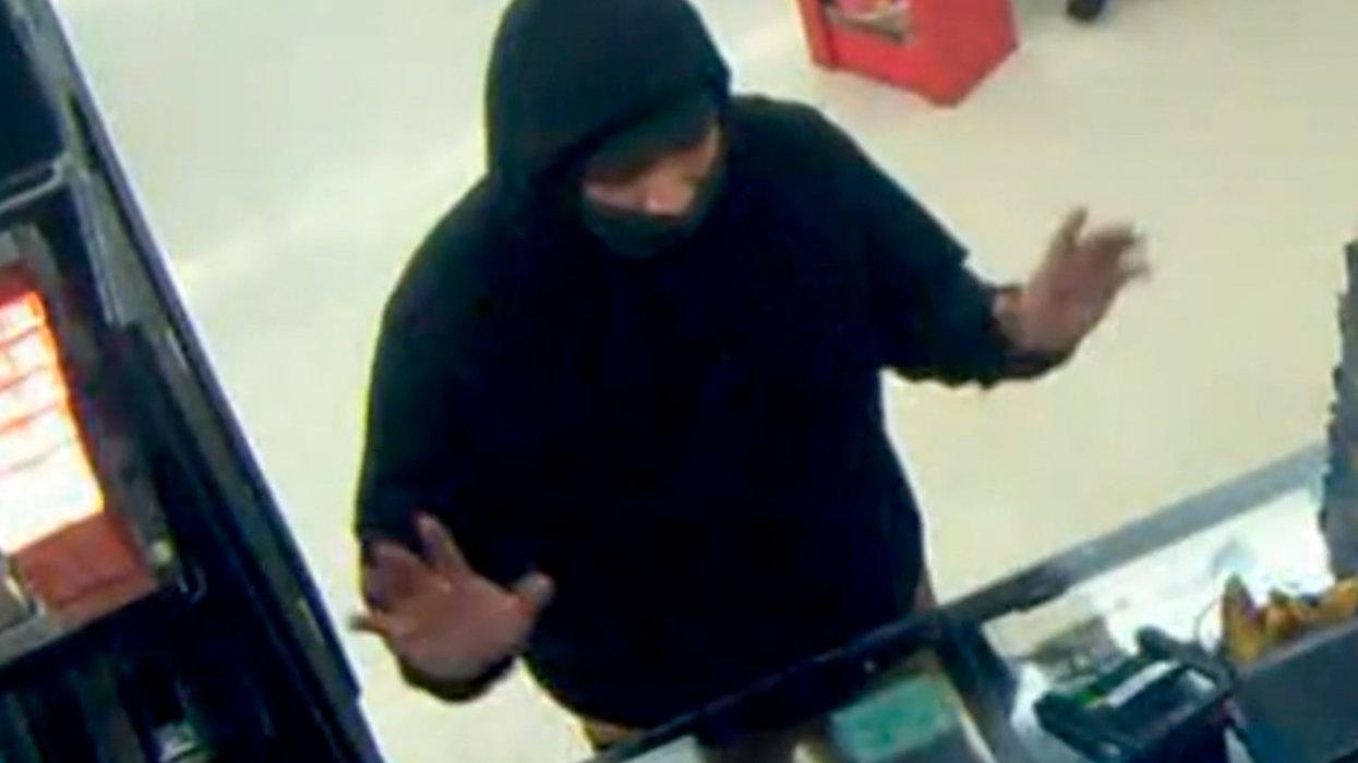 VIDEO: Store clerk FIRED after pulling gun in self-defense against hatchet-wielding robber