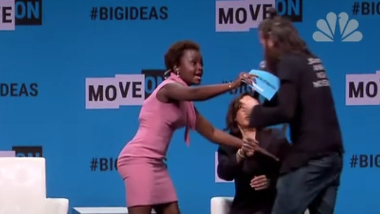 WATCH: Man-bun-sporting hippie rushes stage, rips mic away from Sen. Kamala Harris