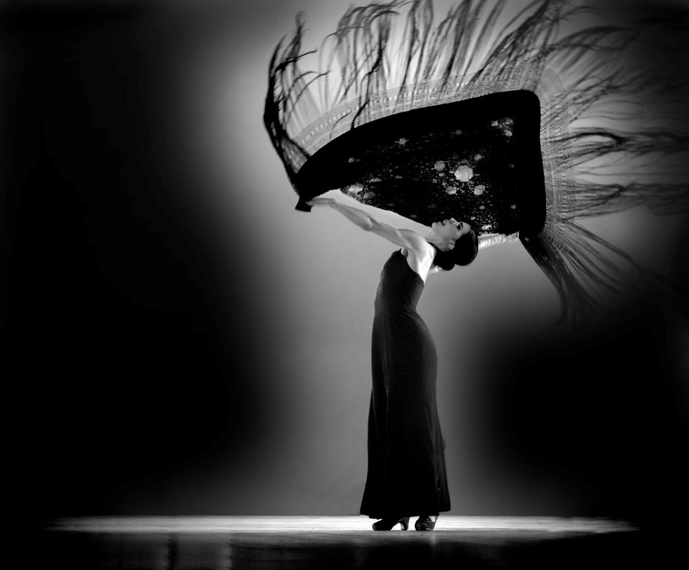 Black and white photo of Irene Rodriguez dancing with a scarf