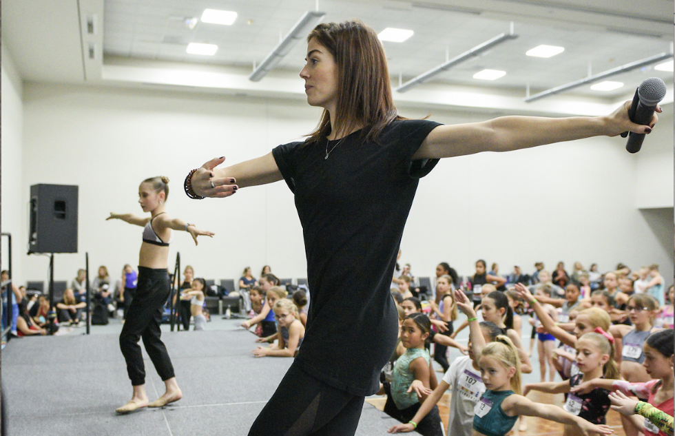 Kayle Kalbfleisch demonstrates to a room full of students