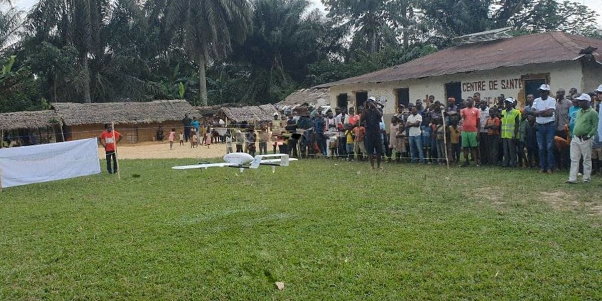 Villagers rejoice as they receive the first vaccines ever delivered via drone in the Congo