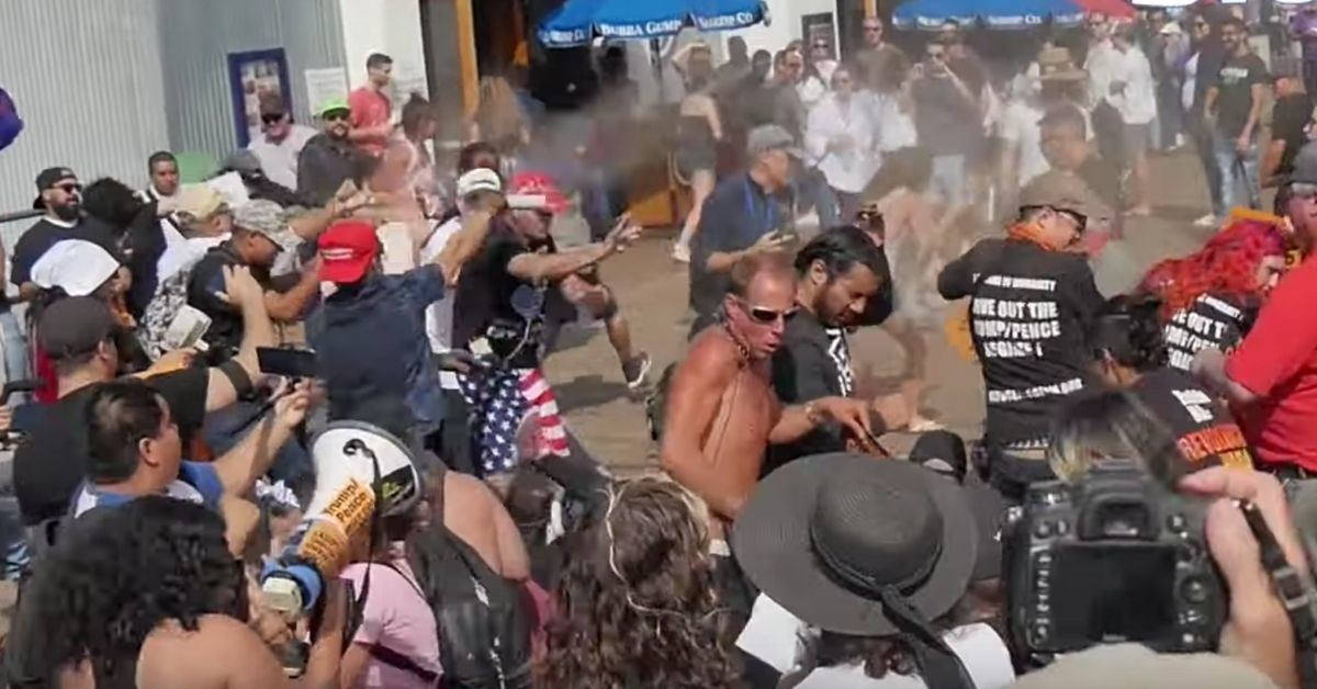 Trump Supporter In MAGA Hat Creates Panic On Pier After Unleashing Bear Spray On Anti-Trump Protesters