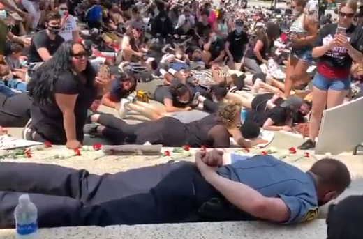 Police chiefs lays face down on ground in BLM die-in protest ...