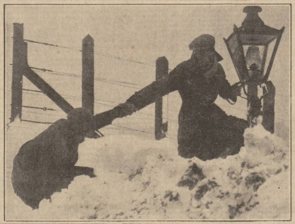 A woman gets a helping hand over a drift in Devon