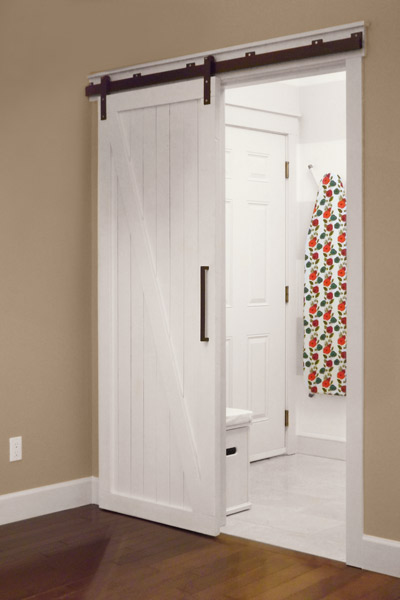 save space with a sliding barn door - The Snug