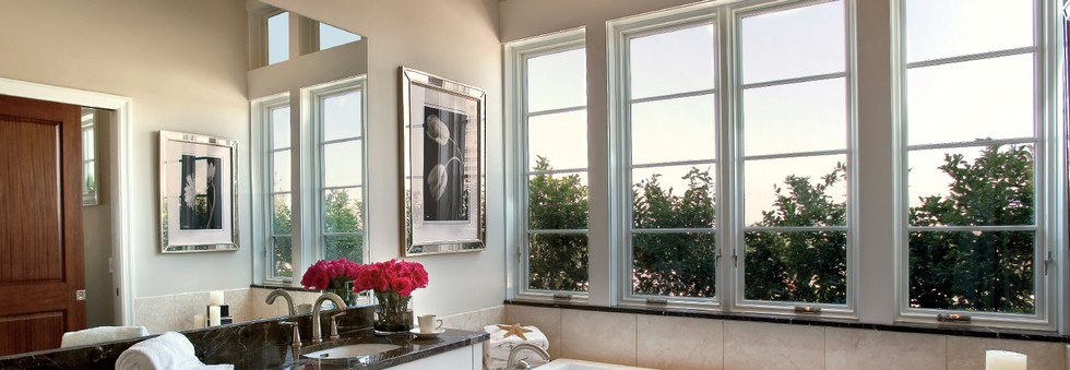 Picture of Pella Insynctive smart shades in a home.