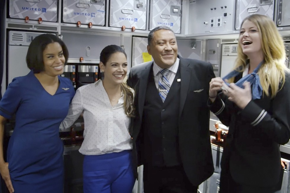 United Flight Attendants Pose for a Photo in the Galley