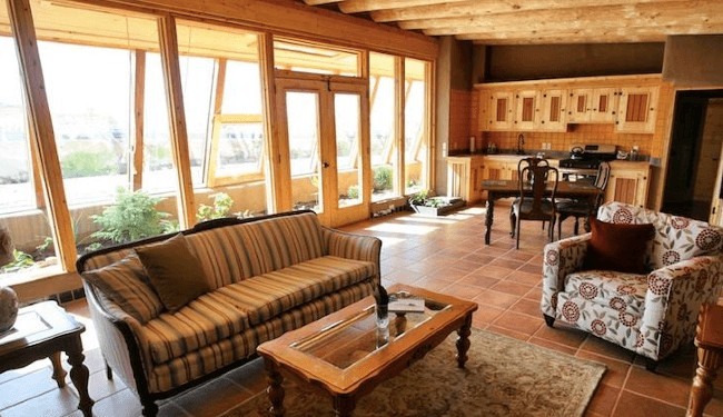 40 incredible photos show why earthships make the perfect home ecowatch. Black Bedroom Furniture Sets. Home Design Ideas