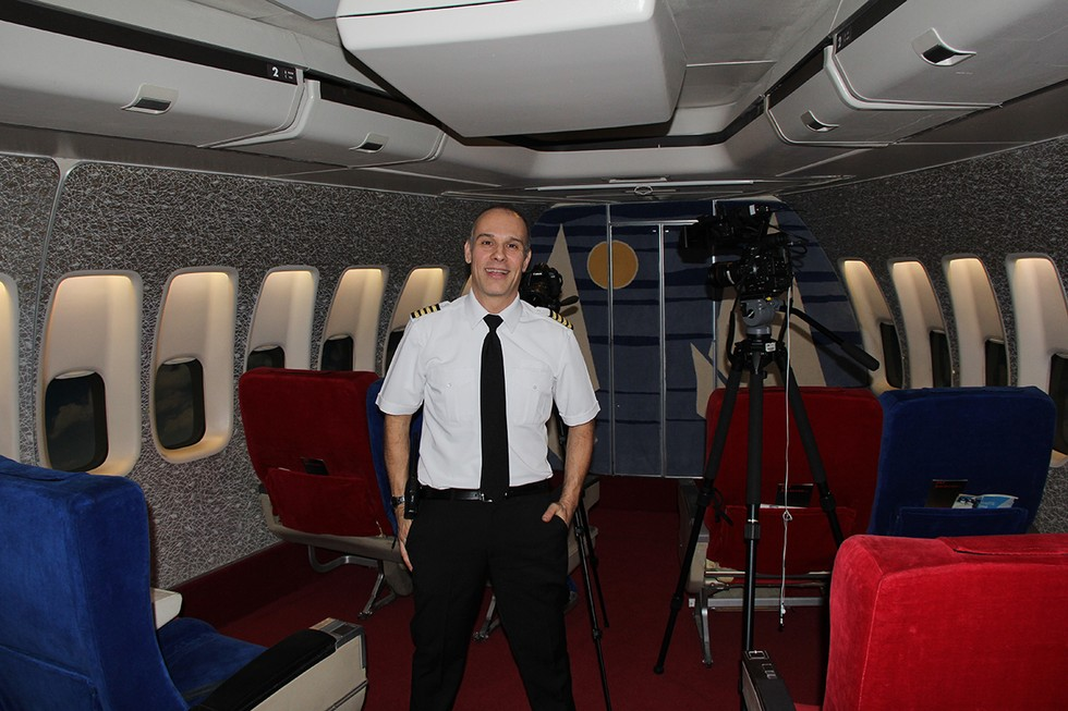 Anthony Toth in a 747 cabin mock-up
