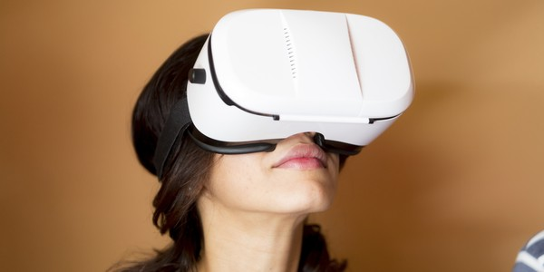 Woman wearing an oculus rift for an immersive entertaining experience