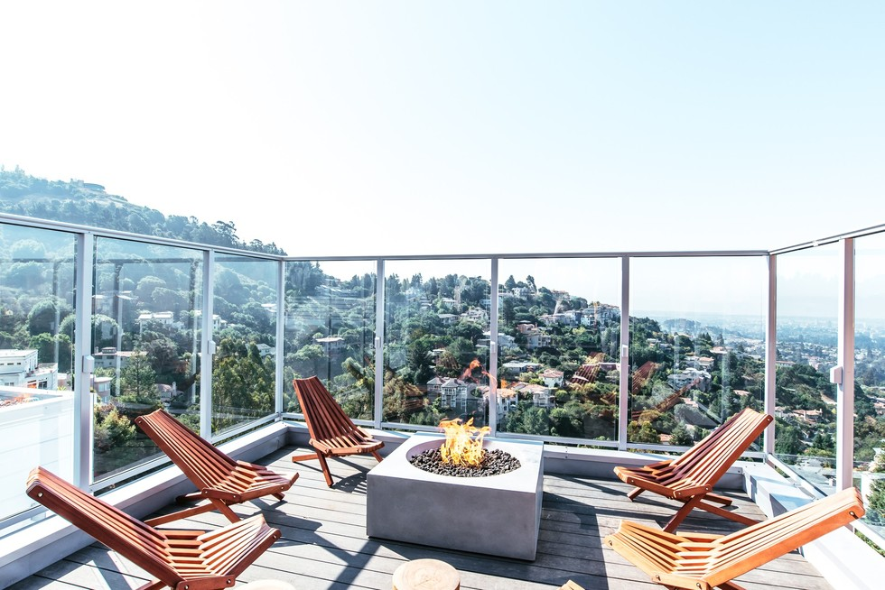 Deck with outdoor fireplace overlooking Berkeley.