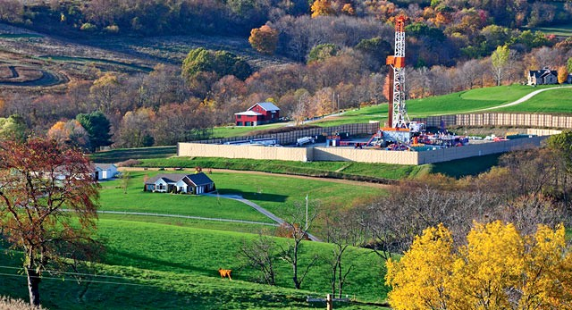 A natural gas rig side by side with homes in Washington County, Pennsylvania.B. Mark Schmerling