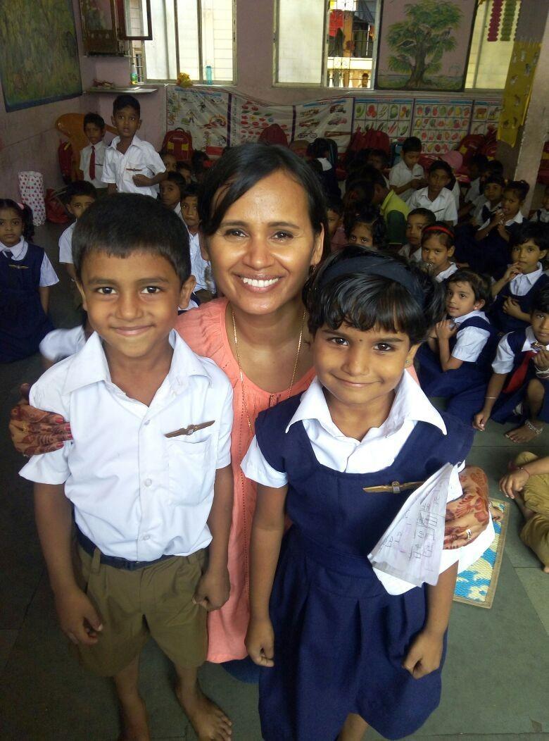 Radha with students in Mumbai